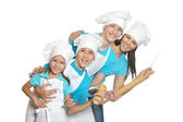 Cheerful chef with assistants — Stock Photo