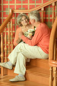 Mature couple on stairs with railing — Stock Photo