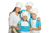 Happy chef with assistants — Stock Photo