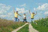 Funny family jumping — Stock fotografie