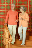 Retired couple on stairs with railing — Stock Photo