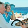 Retired couple ride in boat on sea — Stock Photo #50922263
