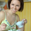 Woman eating at the table — Stock Photo #50922409