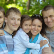 Portrait of friendly family outdoor — Stock Photo