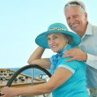 Retired couple ride in boat on sea — Stock Photo #50922913