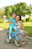 Happy girl on a bicycle — Stock Photo