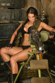 Brunette woman with machine gun — Stock Photo