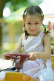 Portrait of little girl on playground — Stock Photo