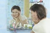 Woman with fresh skin  in bathroom — Stock Photo