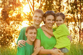 Mother with her children outdoors — Stock Photo