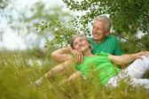 Senior couple in summer field — Stock Photo