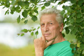 Senior man thinking outddor — Stock Photo
