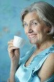 Retired woman drinking tea — Stock Photo