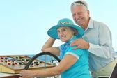 Retired couple ride in boat on sea — Foto Stock