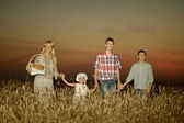 Mom with children  on wheat field — Stock Photo