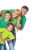 Family in a green clothes — Stock Photo