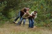 Happy family in autumn forest — Foto de Stock