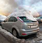 Cars under the snow cap — Stock Photo