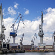 Cranes at shipyard — Stock Photo