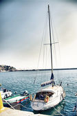 Yacht and boats at the pier afloat — Stock Photo