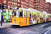 Yellow tram at the stop — Stock Photo