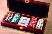 Poker suitcase with poker chips and playing cards — Stock Photo