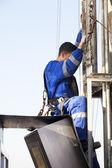 Men at work climbing rig — Stock Photo