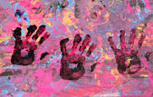 Three Baby hand with paint — Zdjęcie stockowe