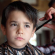 Постер, плакат: Young boy at barber shop