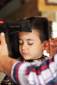 Young boy at barber shop — Stock Photo