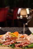 Mixed cold cuts with wine — Stock Photo