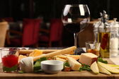 Big mixed cheese plate — Stock Photo
