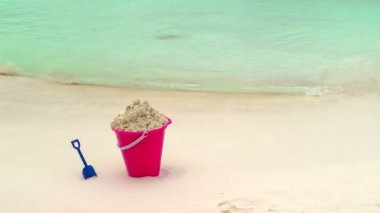 Childs Bucket and Shovel Sitting on Tropical Beach — Stock Video #23657883