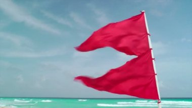 Red Flag Waving on Tropical Beach — Stock Video
