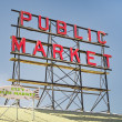 Neon public market sign against sky — Foto de Stock