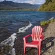 Adirondack Chair by Lake — Stock Photo