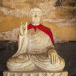 Stock Photo: Stone Buddha at Tibetan Buddhist Monument