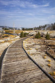 Wooden boardwalk through Upper Geyser Basin — Stock Photo