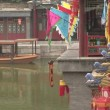 Stock Video: Colorful flags, lanterns, gargoyles and ferry boat on water