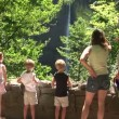Family looking at waterfall — Stock Video