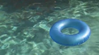 Inner Tube Floating in a Swimming Pool — Stock Video