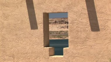 Lake Powell and boat through a window — Stockvideo
