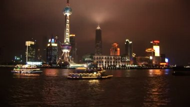 Brightly lit ship passing Shanghai, Pudong — Stock Video