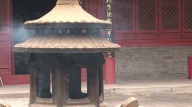 Incense Burner through Doorway — Vídeo Stock