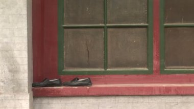 Shoes on a Window Frame — Stock Video