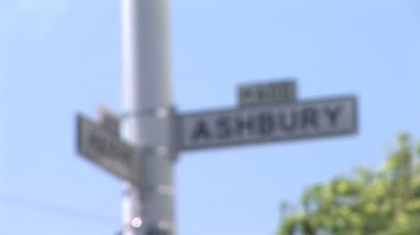 Haight and Ashbury signs against blue sky — Stock Video