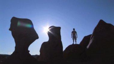 Man on rock in silhouette — Stock Video