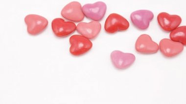 Heart shaped candies texture — Stock Video