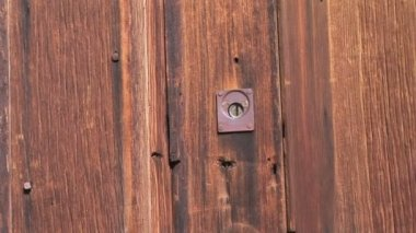 Weathered door and Antique lock in the ghost town of Bodie