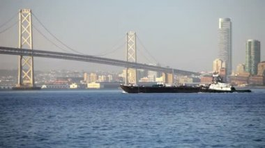 Tugboat at Bay Bridge — Stock Video